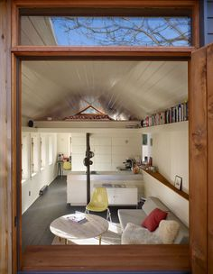 In Seattle, a 320-square-foot garage was recast as a comfortable studio apartment. Light cascades into the living room through a row of six insulated timber windows on the south wall.