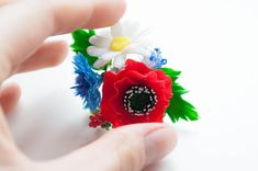 Exclusive handmade ring like a wonderful flower bouquet of blue cornflowers, red poppies and maiden daisies.