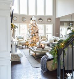 elegant-two-story-great-room-with-christmas-tree-in-front-of-windows