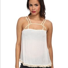 Free people cami top with crochet bottom Brand new with tags.no trades Free People Tops Camisoles