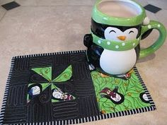 Little mini quilts are now knows as mug rugs in bogland. They are big enough to hold a cup of your drink of choice and a small snack.