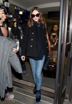 Keira Knightley wasn't afraid to mix black and blue in her ribbed sweater and peacoat. She finished off the...