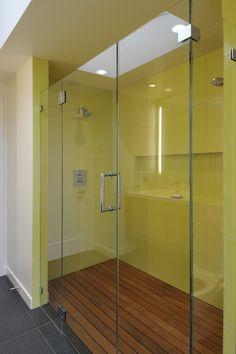 Needs a break between the wooden shower floor vs grey tiles (eg. small white step up)