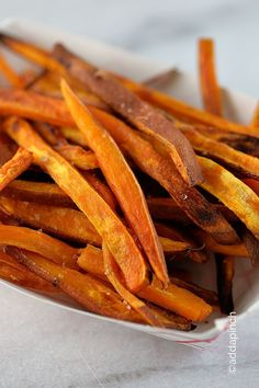 Sweet Potato Fries are simple to make and so scrumptious to eat! Baked in the oven, you'll find yourself making these sweet potato fries as much as possible. //addapinch.com