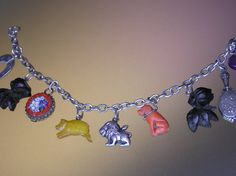 Antique Carved Silver Charm Bracelet by ShiningDreams on Etsy