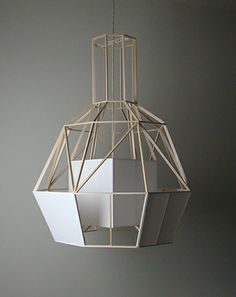 FEATHERLIGHT. The materials used in this design is Balsa and Oracotex, which is used to cover the wings of a glider, weighs almost nothing and gives the lamp it's lightweight.