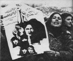 """An Iranian woman holds a poster that reads, """"Liberation of women is the liberation of society"""" March 8, 1979"""