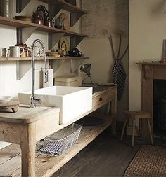 kitchen sink set in farmhouse table, architectural salvage, fireplace,  England