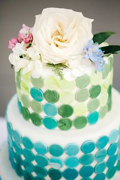wedding cake in shades of blue + green // photo by Jody Savage Photography