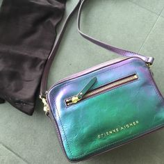 Etienne aigber irisdescent handbag Never worn. Fun color. Crossbody. It was two comparments + front zipper + back pocket. Detachable strap. Comes with dust bag and the original tag Etienne Aigner Bags Crossbody Bags