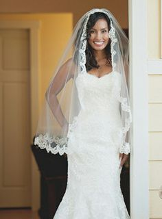 This stunning Maggie Bride, Gina, accented her Lavina gown with this lace-hemmed waist-length veil.