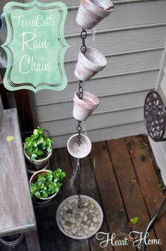 Source: All Things Heart & Home A cute take on the flower pot rain chain idea, this example features an antiquing effect achieved using paint. It also features a basin at the bottom, a useful addition which helps anchor the chain and collects rainwater for eco-friendly re-use.