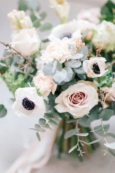 lush bouquet with anemones - photo by Julien Bonjour Photographe http://ruffledblog.com/airy-industrial-wedding-inspiration-for-spring