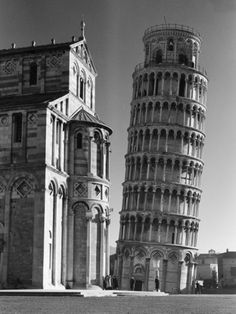 Tower of Pisa Standing Next to the Baptistry of the Cathedral  by Margaret Bourke-White Item #: 4326289