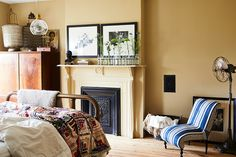 Mellow Yellow - Designer Chris Benz's Colorful Brooklyn Brownstone - Photos The creamy yellow and the blue chair Maneki Neko, Eclectic Fireplaces, Feng Shui, Fireplace Shelves, Brooklyn Brownstone, Simple Furniture, Mellow Yellow, Take A Seat, Decoration