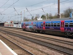 First Capital Connect class 365 heading South to London with graffiti on the side of it.     For more information about Dog Training Classes visit http://www.k9korralsrq.com/