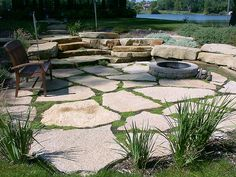 Love this flagstone patio, just lose the fire pit and get grey stones instead of tan.