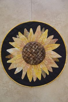 Sunflower from Trouble & Boo Designs, table topper pattern. Pattern available at 35th Ave. Fabric World in Phoenix and your local quilt shop can get it for you from Checker Distributors or Brewer Quilting & Sewing Supplies (distributor).