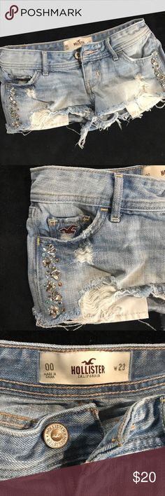 Distressed Hollister Rhinestone Shorts Size 00 Size 00 W23 Hollister shorts, semi-distressed with some rhinestone decorations. Waist laying flat measures 13.5in. Length of side of shorts laying flat is about 8in. Tags: short cute summer spring beach coverup sparkle Hollister Shorts Skorts