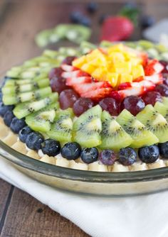 A fresh fruit pie with a sugar cookie crust, a light cheesecake filling, topped with loads of fresh fruit, and lightly glazed with fruit