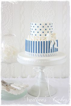 Pale blue and white cake with stripes and dots