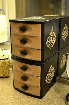 Why didn't I think of this! Great way to make those ugly plastic drawers match the rest of the bathroom decor.