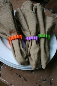 Halloween fangs into napkin rings :) On paper napkins for the kids' Halloween party.