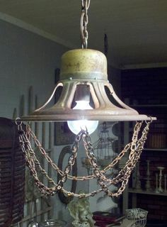 Lamp made from old speaker and chains.