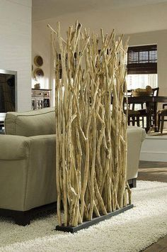 DIY Room Divider Phillips Collection Stick Screen Non Bucket List of unorganized day .Biombo com ramos. Phillips Collection Stick Screen - a good way to separate space in a small city apartment or studioThinking a screen like this or old shutters to