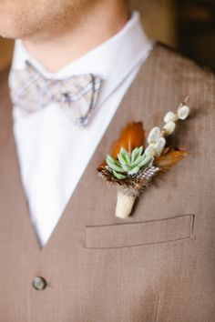 succulent, feather and pussy willow boutonniere