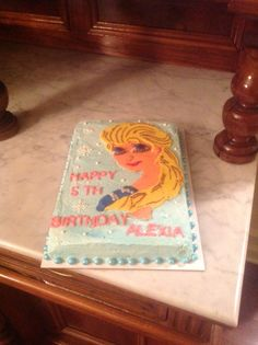 Frozen's elsa in modeling chocolate marble cake with vanilla buttercream