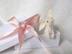 Bunny pocket rabbit, white felt Loveling bunny to hang everywhere or carry in your pocket. $28.95, via Etsy.