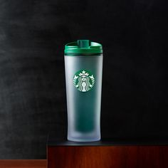 An+acrylic,+double-walled+tumbler+with+a+soft,+frosted+outer+sleeve+and+green+interior.