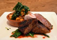 Smoked Paprika and Sumac Dusted Lamb Loin with blood orange gastrique, housemade hominy-chorizo hash, wilted greens and orange-cardamom spiced labneh (dinner) | Green Valley Grill | Greensboro, NC