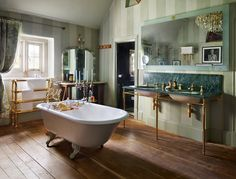 A charming country retreat, the master bathroom of Kate Moss's Cotswolds home features a range of classic pieces from Drummonds: the Double Lowther vanity with striking Verde Guatemala marble forms a focal point of the room, whilst respecting the heritage of the building. Painted Wardrobe, Cast Iron Bath, Classic Baths, Grand Art, Vanity Basin, Roll Top Bath, Bath Shower Mixer, Double Sink Vanity, Striped Walls