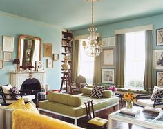 Liking this blue and yellow thing. ice blue walls, mirrors and yellow couch cushions? yellow futon cover. dark blue couch.
