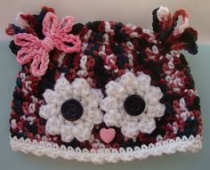 cute owl hat. I have no idea how to crochet - who wants to make this for me?? :)