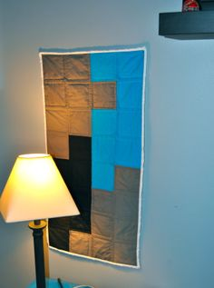 Wall hanging in Carolina Panthers colors.