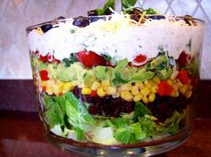 Tex Mex  7  Layer Salad from Food.com: This will be hit at any party not just for taste but for A beautiful presentation of a Tex Mex 7 layer salad. Lots of flavor. The green salsa consists of Tomatillos, Onions, Chilies, Cilantro. Try one of these Salsa Verde or Smoky, Spicy Tomatillo Salsa Verde Aka Green Hell! or buy your favorite brand of Salsa Verde. Salad can be made the day before and refrigerated.