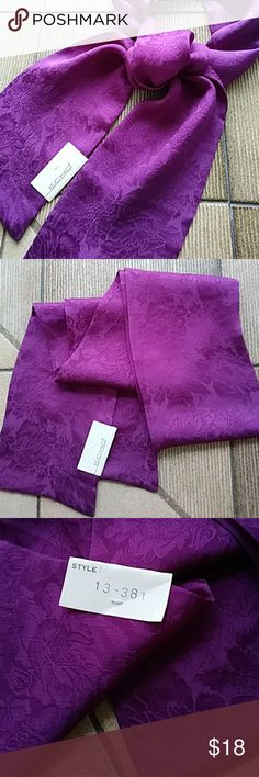 """Just in! 100% Silk ECHO Slim Scarf - Purple New with tags ECHO Slim Scarf. 100% Japanese  silk, made in Japan. Solid purple with floral motif. ECHO Style #13-381. Color variation in photos is from play of natural light on silk.  Slim, rectangular 4-5/8"""" x 52"""" Echo Accessories Scarves & Wraps"""