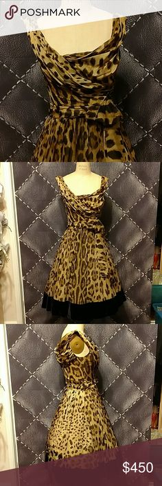 Dolce and Gabbana Silk Chiffon Leopard party dress Sexy and gloriously Beautiful ❣️ Size 40. Purchased at Bergdorf Goodman in early 2000s. Fully lined with boning corset. Side zip. Silk velveteen boarder. Amazing draped neckline. Shirring at sides. Long Beautiful attached chiffon belt. Pristine condition. Wore 2-4 times. Clean. Odorless. Dolce & Gabbana Dresses Midi