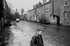 Bradford, 1969. A boy standing in the rain on Forster Steet
