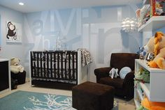 http://www.roomzaar.com/rate-my-space/Nurseries/Modern-Boys-Nursery/detail.esi?oid=513800  Cool baby boy nursery! Dark wood crib with baby blue graphic walls! Chocolate brown velvet glider and ottoman, turquoise graphic rug and crisp white floating shelves finish this space!