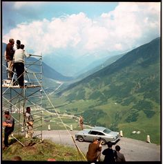 Health & Safety FAIL!! lol   #JamesBond    Filming on location at the Furka Pass, Switzerland. GOLDFINGER ©1964 Danjaq, LLC and United Artists Corporation. All rights reserved.