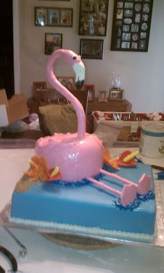 A flamingo cake that is chocolate with a rasberry filling