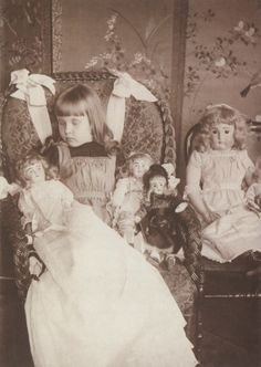 ca. 1900, [Post-mortem portrait of a child with her dolls...so sweet...a little angel...what some people don't realize is that this child may have died without ever having her photograph taken...if her family had not taken one at the time of her death, they would never have an image of her. Also, some believed that the souls of those who passed away could live on in the photos.