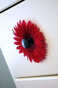 "using silk flowers as knob backs on dressers (just screw knob on, placing it through the center of the flower) adds just that little ""extra"" something! cute for little girls room or play room"