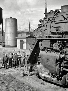 Women wipers of the Chicago & North Western Railroad going out to work on an engine at the roundhouse in Clinton, IA in May 1943.