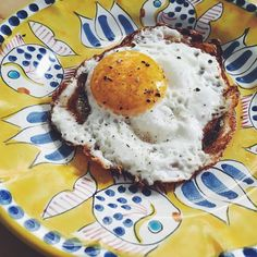 Our favorite way to make eggs? Heat 1-2 Tbsp. olive oil in a medium skillet until very hot. Crack an egg into the pool of oil sprinkle with salt and pepper and cook until the whites are set and the edges are lacy and crunchy and brown. You'll never cook them in butter again! #howwebrunch #eggs #oliveoil #breakfast