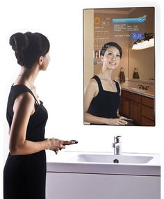 Check it: There's a real life magic mirror! That's right, Cybertecture took tech and made fairytale-worthy awesomeness for your home.